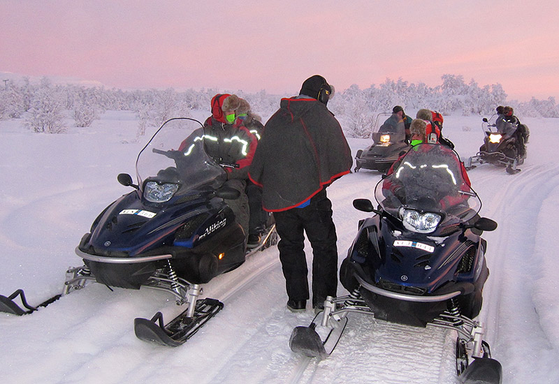 High mountain overnight tour with snowmobile